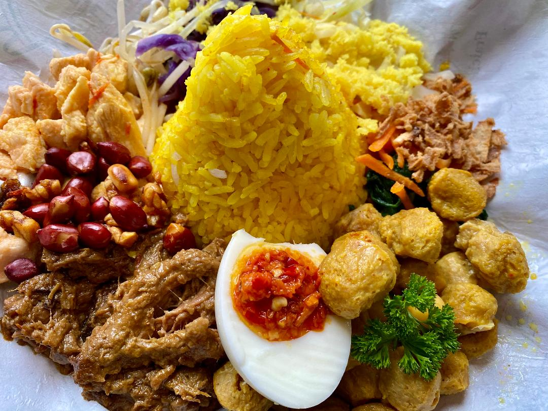 Nasi Bali - Bali Mixed Rice or Vegetarian - Balinese mixed rice prepared with curcuma, spicy egg, tofu, urap vegetable+grated coconut, with shredded chicken+beef rendang (or vegetarian)